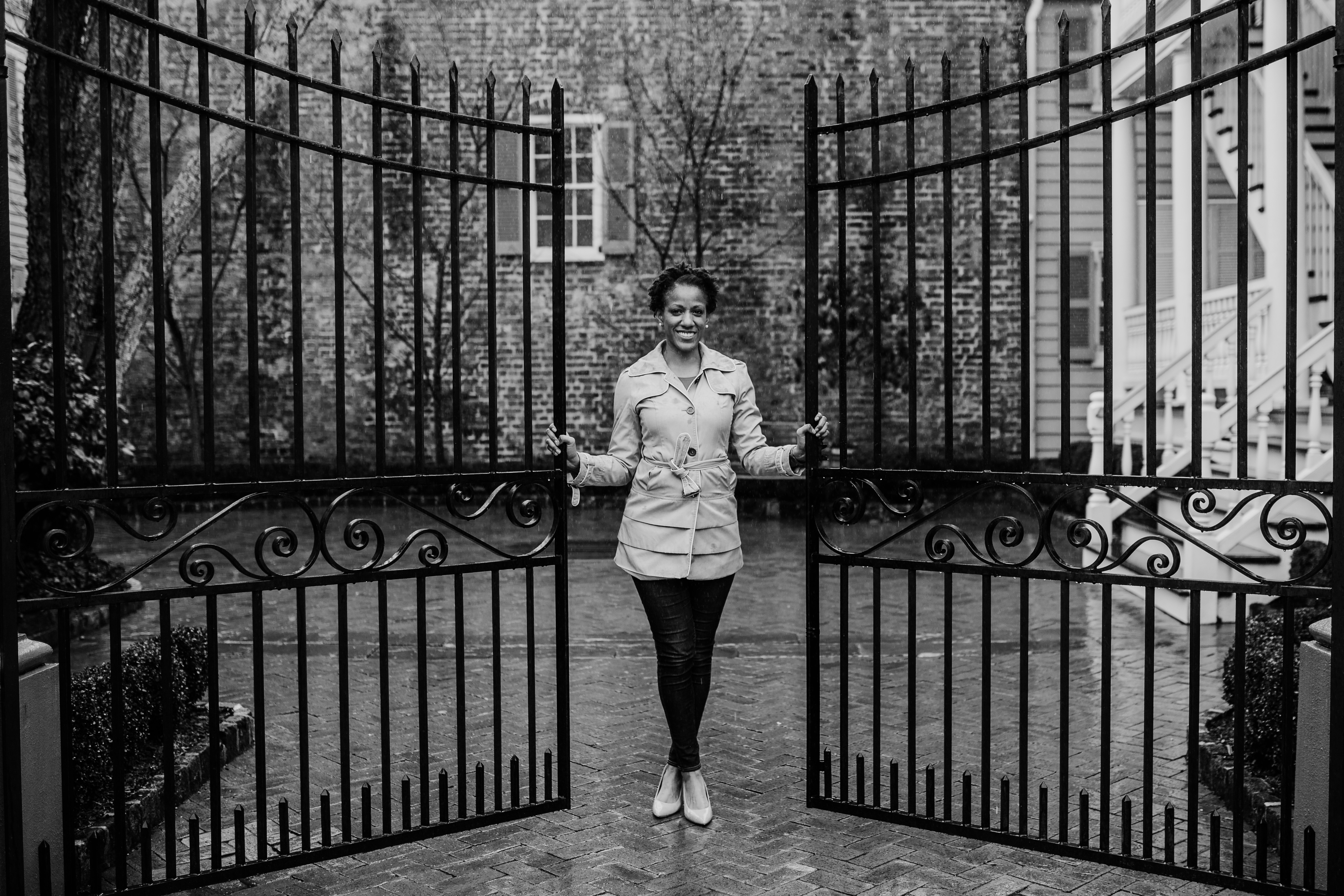 Charneice stands between two iron gates and a stately home, smartly dressed, welcoming visitors.